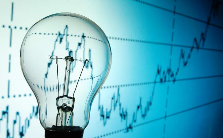 light bulb in front of financial graph